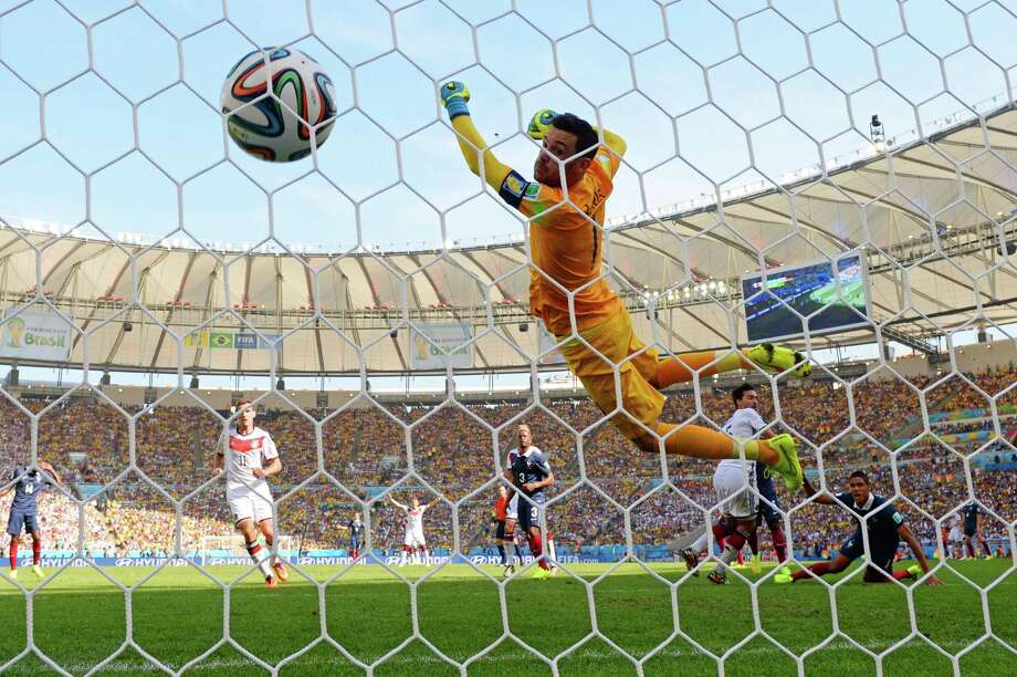 France goalkeeper Hugo Lloris is helpless to prevent a header by Mat Hummels from finding the net in the 13th minute Friday. Photo: Matthias Hangst, Staff / 2014 Getty Images