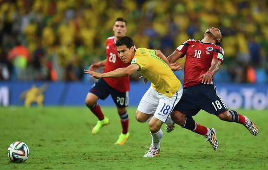 Hernanes (18), outracing Juan Camilo Zuniga, and Brazil are in the semifinals for the first time since 2002. Photo: Jamie McDonald / Getty Images / 2014 Getty Images