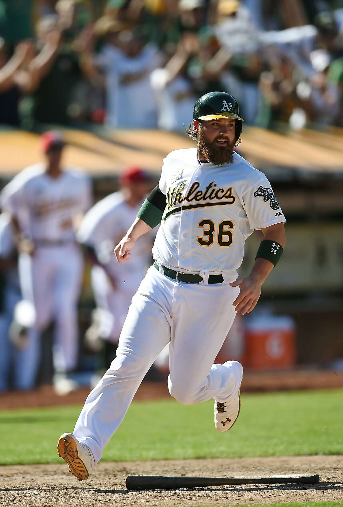OAKLAND, CA - JULY 04: Derek Norris #36 of the Oakland Athletics scores the winning run in the bottom of the 12th inning against the Toronto Blue Jays at O.co Coliseum on July 4, 2014 in Oakland, California. Norris scored from first base on a walk-off rbi double from Nick Punto #1. (Photo by Thearon W. Henderson/Getty Images)
