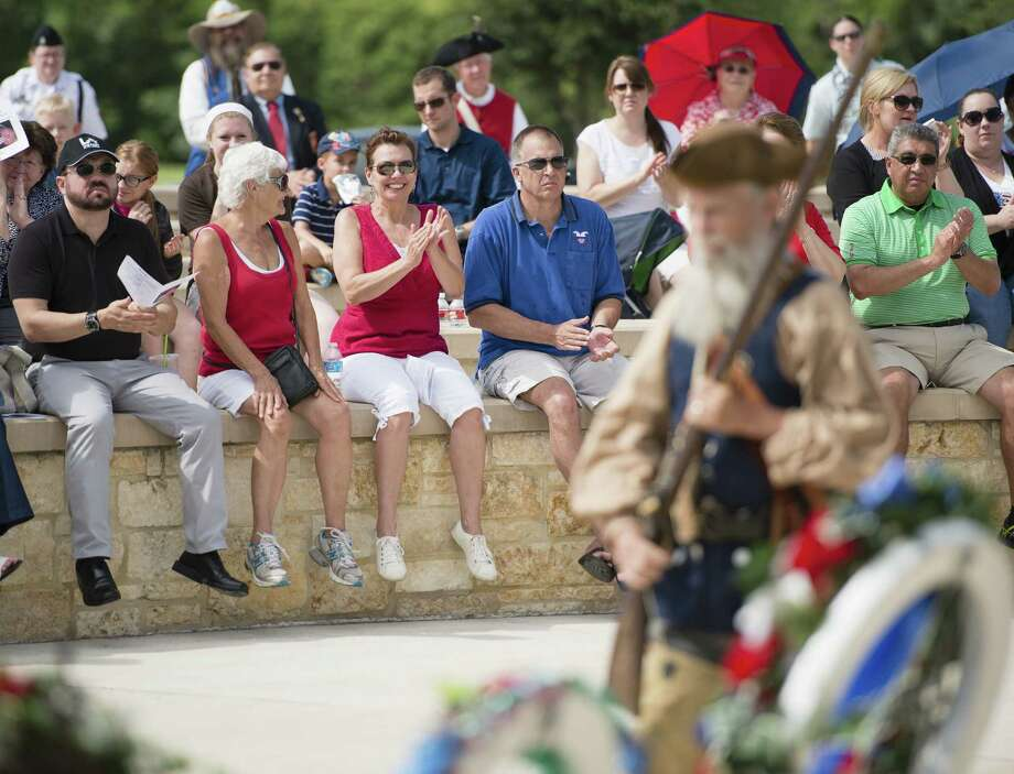 Spectators enjoy an Independence Day ceremony at Fort Sam Houston National Cemetery. A President Washington impersonator receives a standing ovation. Photo: Darren Abate / For The San Antonio Express-News / DA Media, LLC