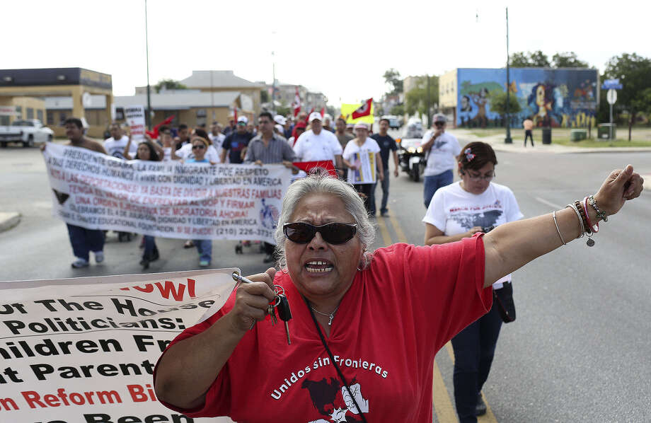 Juanita Reyna and others in the march want the president to end arrests and deportations of hardworking immigrants. Photo: Photos By Lisa Krantz / San Antonio Express-News / SAN ANTONIO EXPRESS-NEWS