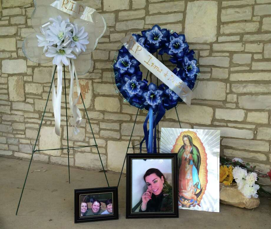 Neighbors and family members built a memorial to Irma Davila and her daughter, Destiny, on their front porch of the home in the 400 block of Globe Avenue. Photo: Drew Joseph / San Antonio Express-News