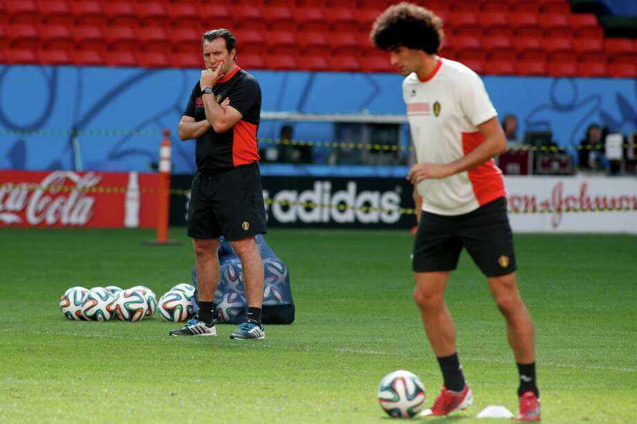 Belgium head coach Marc Wilmots, left, eyes Marouane Fellaini during Friday's training session at Estadio Nacional in Brasilia, Brazil. Photo: Eraldo Peres, STF / AP