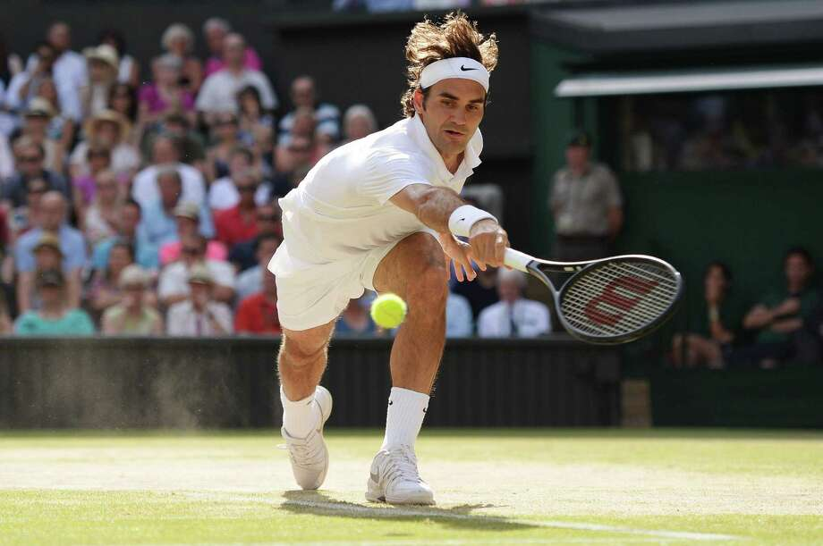 The 2012 Wimbledon title was the last in a Grand Slam for Roger Federer, above. But after beating Milos Raonic, he gets the chance at his 18th major crown. Photo: Tony O'Brien, MBR / Zuma Press