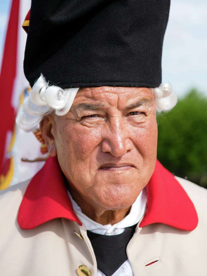 Tenth-generation San Antonio native Joe Zavala, dressed in a period-style Spanish army uniform, poses for a portrait during an Independence Day ceremony on Friday, July 4, 2014, at Fort Sam Houston National Cemetery in San Antonio. (Darren Abate/For the Express-News) Photo: Darren Abate, Darren Abate/Express-News / DA Media, LLC