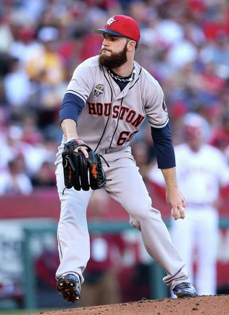Dallas Keuchel didn't help his All-Star chances with Friday's outing, in which he allowed five runs, 13 hits and a walk in five innings against the Angels. Photo: Stephen Dunn, Staff / 2014 Getty Images