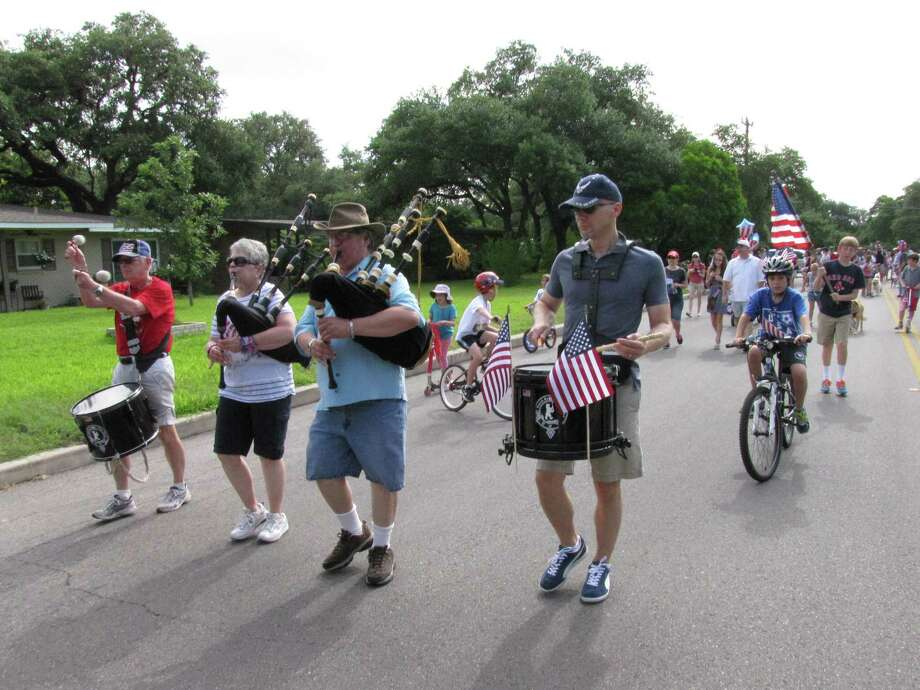 Black Bexar Piper Band leads off the Oak Park/Northwood Neighborhood Association's Fourth of July parade on Friday. Photo: Edmond Ortiz / Alamo Heights Wee
