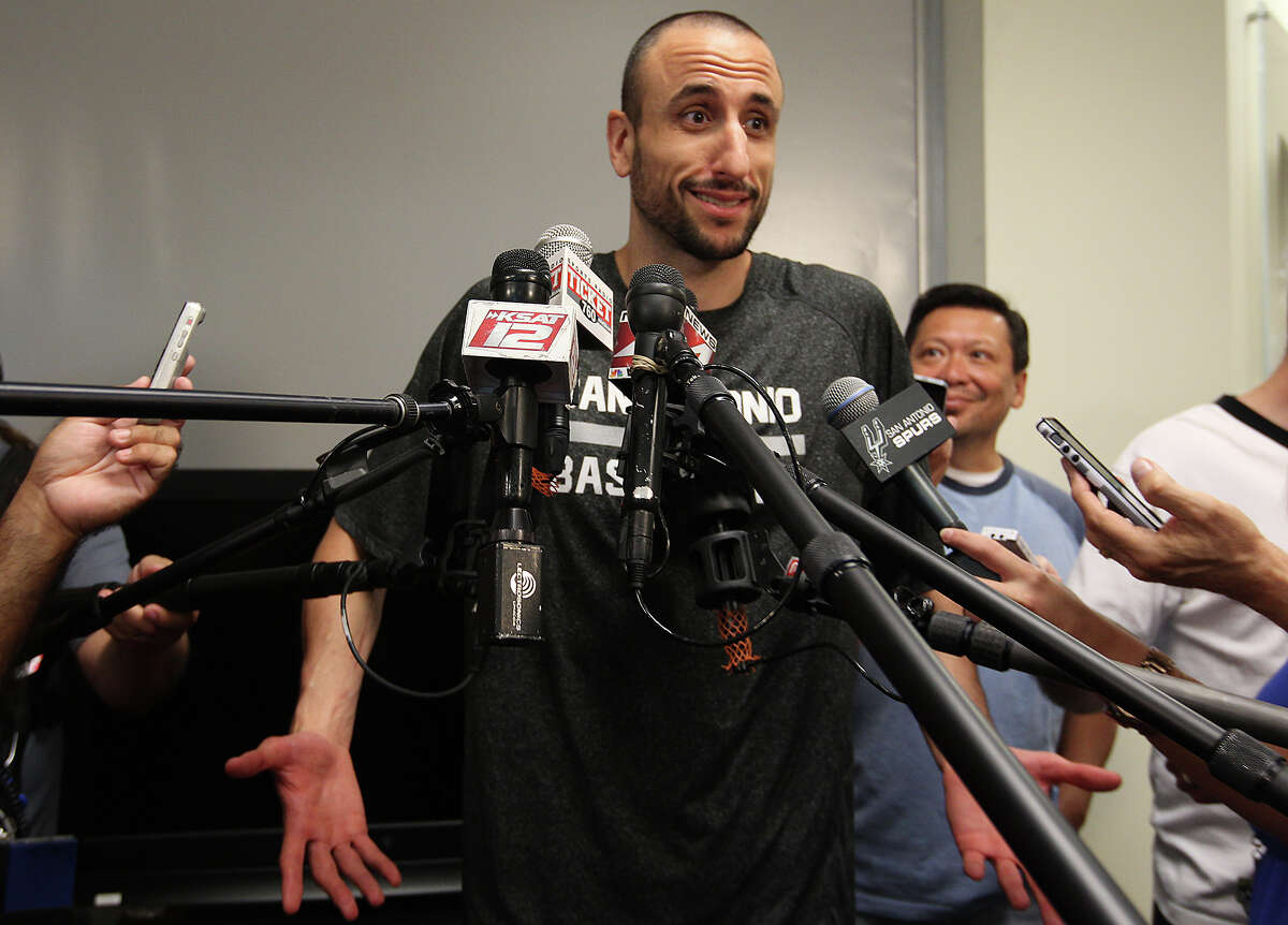 San Antonio Spurs' Manu Ginobili talks with media at the practice facility, Tuesday, June 17, 2014. The players were cleaning out their lockers after a winning season. They defeated the Miami Heat in the NBA Finals series, 4-1, to claim the championship..