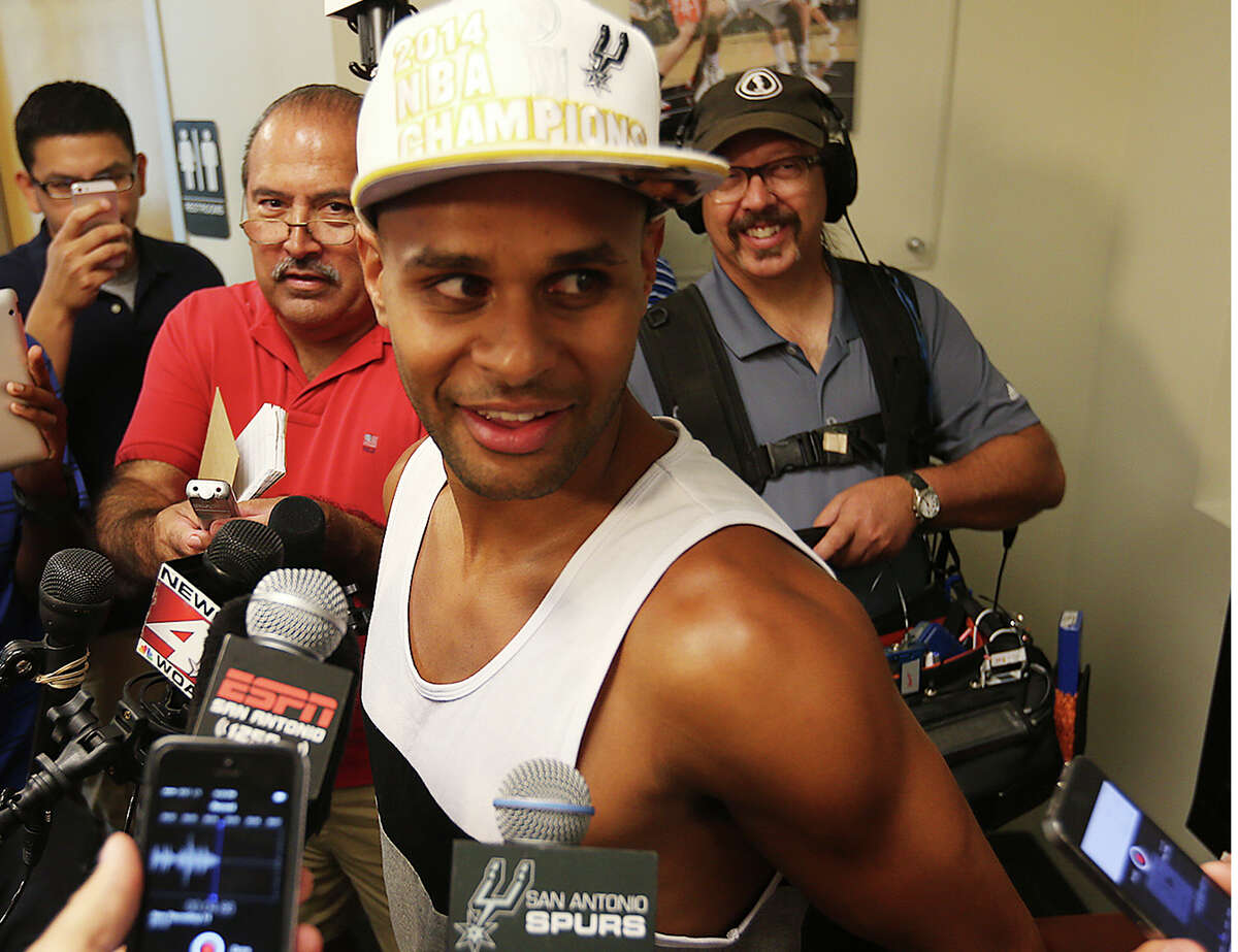 San Antonio Spurs' Patty Mills talks with media at the practice facility, Tuesday, June 17, 2014. The players were cleaning out their lockers after a winning season. They defeated the Miami Heat in the NBA Finals series, 4-1, to claim the championship.