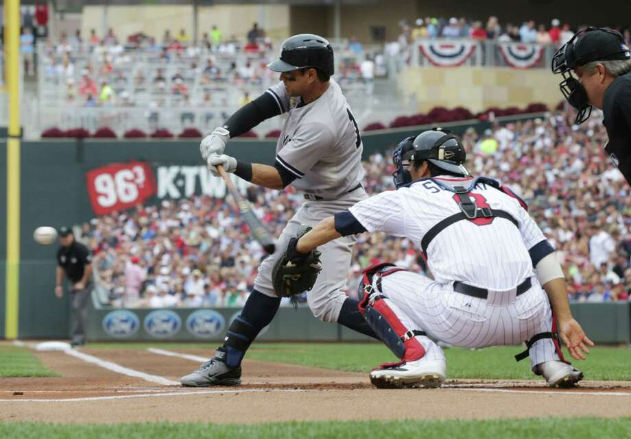 New York Yankees' Brian Roberts swings to hit an RBI-double in the first inning of a baseball game against the Minnesota Twins, Friday, July 4, 2014, in Minneapolis. The Yankees won 6-5. (AP Photo/Jim Mone) ORG XMIT: MNJM117 Photo: Jim Mone / AP