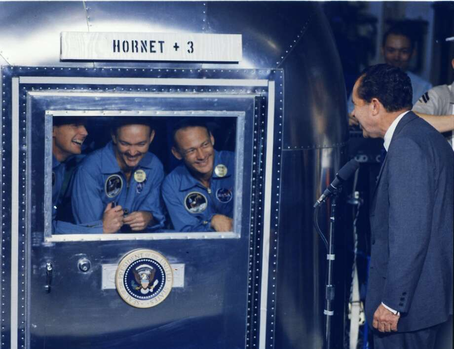 "ap11-S69-21365HR - ""The Apollo 11 astronauts, housed in the quarantine facility, are  greeted by President Nixon onboard the recovery ship USS Hornet (CVS-12) – July 24,  1969. L to r – Neil Armstrong, Michael Collins, Buzz Aldrin"" Photo: USS Hornet"