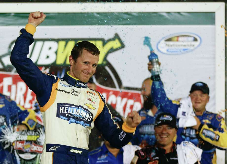 Kasey Kahne celebrates in Victory Lane after winning the NASCAR Nationwide series auto race at Daytona International Speedway in Daytona Beach, Fla., Friday, July 4, 2014. (AP Photo/John Raoux) ORG XMIT: DBR129 Photo: John Raoux / AP