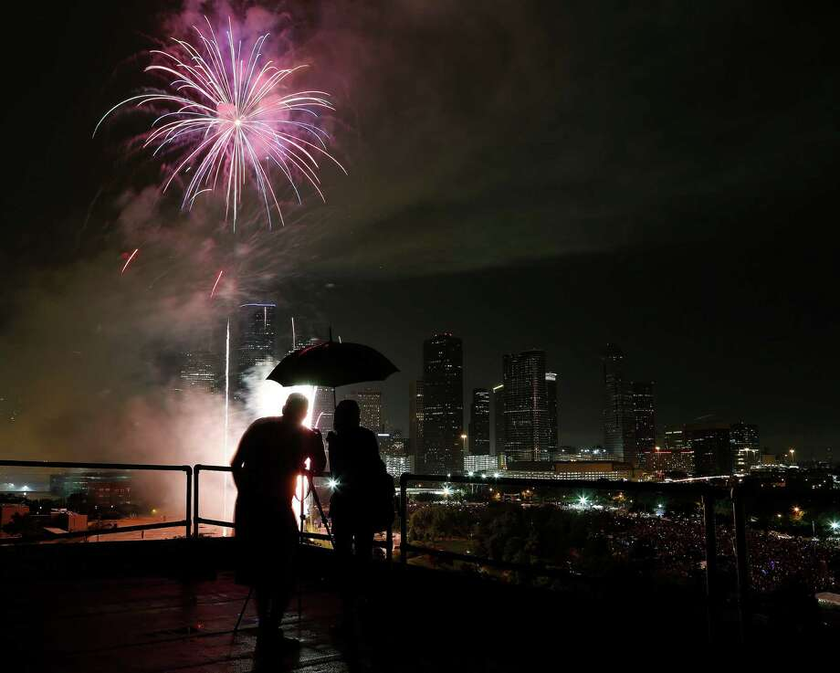 Fireworks light up the downtown skyline during the 2014 Southwest Airlines Freedom over Texas at Eleanor Tinsley and Sam Houston Parks, Friday, July 4, 2014, in Houston. Photo: Karen Warren, Houston Chronicle / © 2014 Houston Chronicle