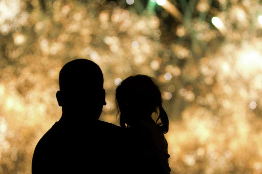Gabriel Gonzalez watches the fireworks with his daughter Gabby, 3, during the Freedom Over Texas Fourth of July celebration at Eleanor Tinsley Park on Friday, July 4, 2014, in Houston. Photo: J. Patric Schneider, For The Chronicle / © 2014 Houston Chronicle