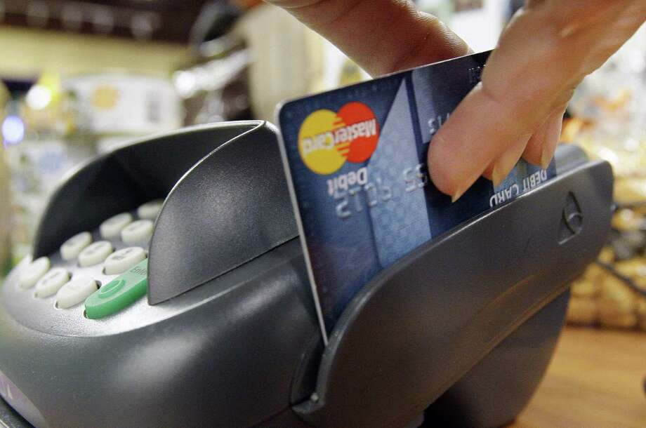 Banks and card networks are testing a system that verifies transactions through the shopper's smartphone location. Photo: Associated Press / AP2009