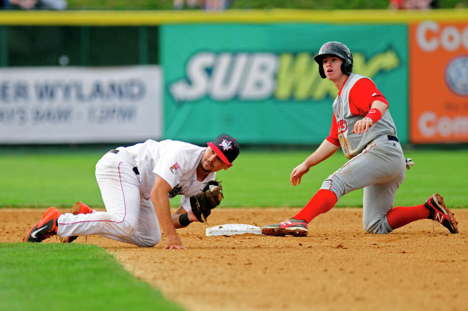 Valley Cat short stop Mott Hyde #4 looks for the umpire's call after attempting to tag out a Lowell baserunner on Friday, July 4, 2014, in Troy, NY. (Tom Brenner / Special to the Times Union) Photo: Tom Brenner / ©Tom Brenner/ Albany Times Union