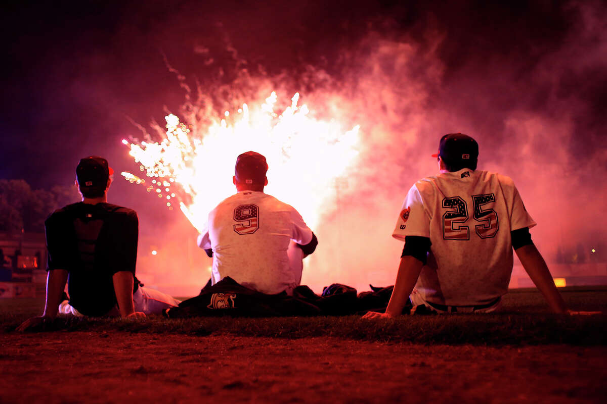 Valley Cat teammates Joe Musgrove #34 left, Vince Wheeland #9, and Jordan Mills #25 right, watch Independence day fireworks from the infield after a game against the Lowell Spinners on Friday, July 4, 2014, in Troy, NY. (Tom Brenner / Special to the Times Union)