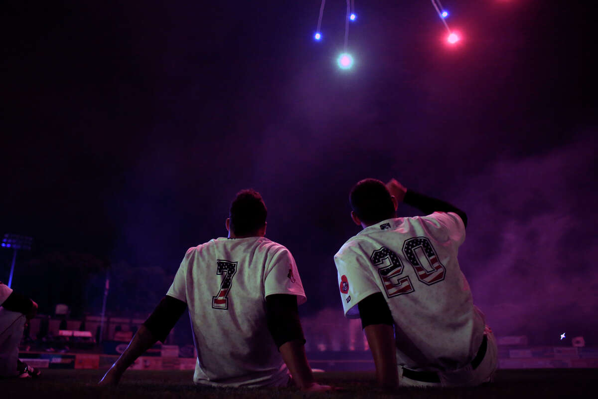Valley Cat teammates Alfredo Gonzalez #7, and Raul Rivera #20 watch Independence day fireworks from the infield after a game against the Lowell Spinners on Friday, July 4, 2014, in Troy, NY. (Tom Brenner / Special to the Times Union)