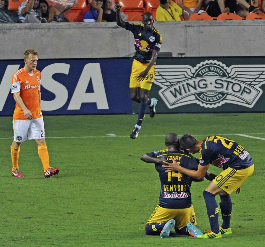 New York Red Bulls forward Thierry Henry, seen kneeling after scoring against the Dynamo in July, was again a nemesis for Houston on Saturday night. Photo: Eric Christian Smith, For The Chronicle / Eric Christian Smith