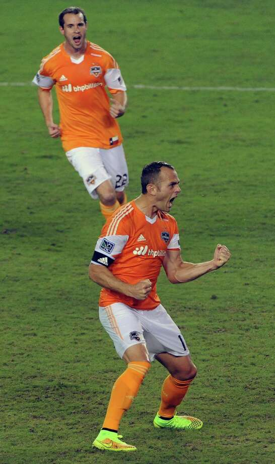 Houston Dynamo midfielder Brad Davis, bottom, celebrates his equalizing goal in the 82nd minute as teammate forward Brian Ownby looks on during the second half of an MLS soccer game against the New York Red Bulls, Friday, July 4, 2014, at BBVA Compass Stadium in Houston. Photo: Eric Christian Smith, For The Chronicle / Eric Christian Smith