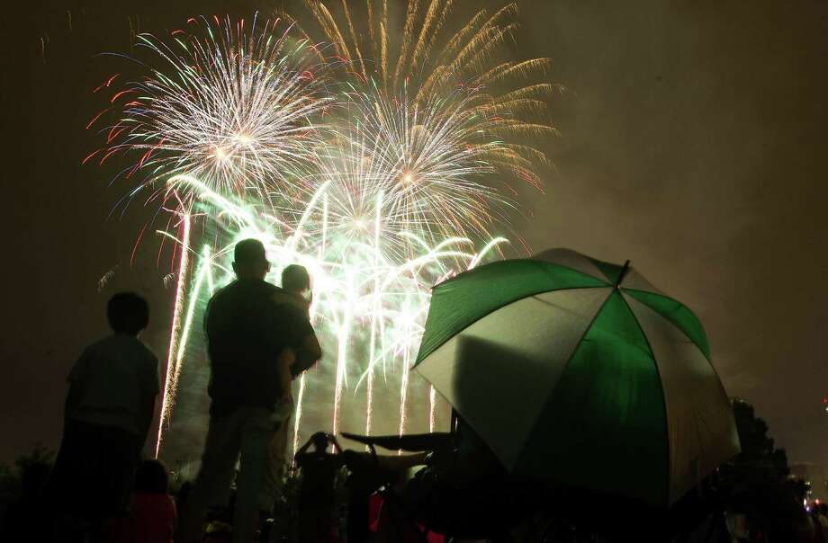 Fireworks light up the sky during a wet Freedom Over Texas Fourth of July celebration at Eleanor Tinsley Park on Friday, July 4, 2014, in Houston. Photo: J. Patric Schneider, For The Chronicle / © 2014 Houston Chronicle