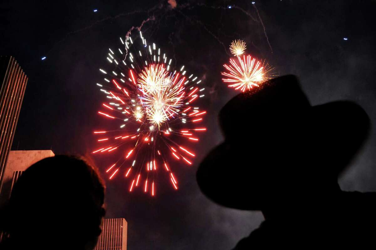 Spectators take in the fireworks display during the Fourth of July celebration on Friday July 4, 2014, at the Empire State Plaza in Albany, N.Y. (Cindy Schultz / Times Union)
