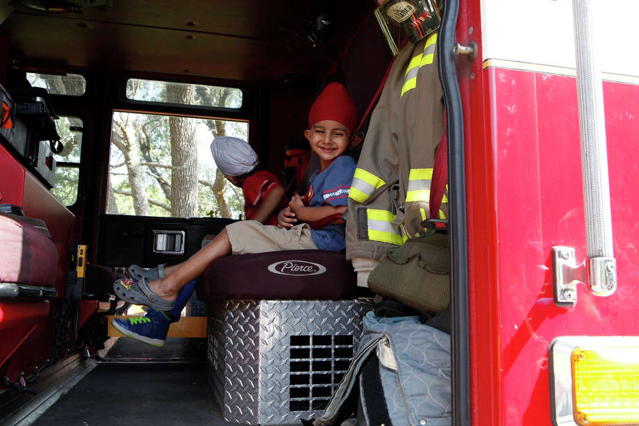 Kubbi Singh, 3, looks around the inside of a fire engine from Station 34  July 4, 2014 after the 17th annual HIlls & Dales Neighborhood Association Fourth of July parade. The parade which lasted about a quarter of a mile had over 100 people participate while walking the two long block of Shady Hollow Lane off of Babcock Road. Photo: For The San Antonio Express-News / For the San Antonio Express-News