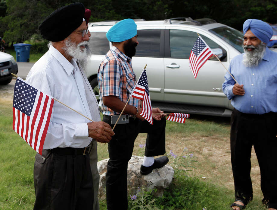 Members of the Sikh Dharamsal congregation participate for the first time July 4, 2014 in the 17th annual HIlls & Dales Neighborhood Association Fourth of July parade. The parade which lasted about a quarter of a mile had over 100 people participate while walking the two long block of Shady Hollow Lane off of Babcock Road. Photo: For The San Antonio Express-News / For the San Antonio Express-News