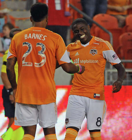 Dynamo forward Giles Barnes (23) celebrates with Kofi Sarkodie after scoring a goal in the first minute of Friday's match against New York. Photo: Eric Christian Smith, Freelance / Eric Christian Smith