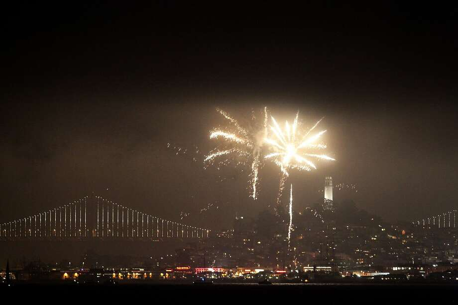 Fireworks glow over San Francisco, Calif., on Friday, July 4, 2014. Photo: James Tensuan, The Chronicle