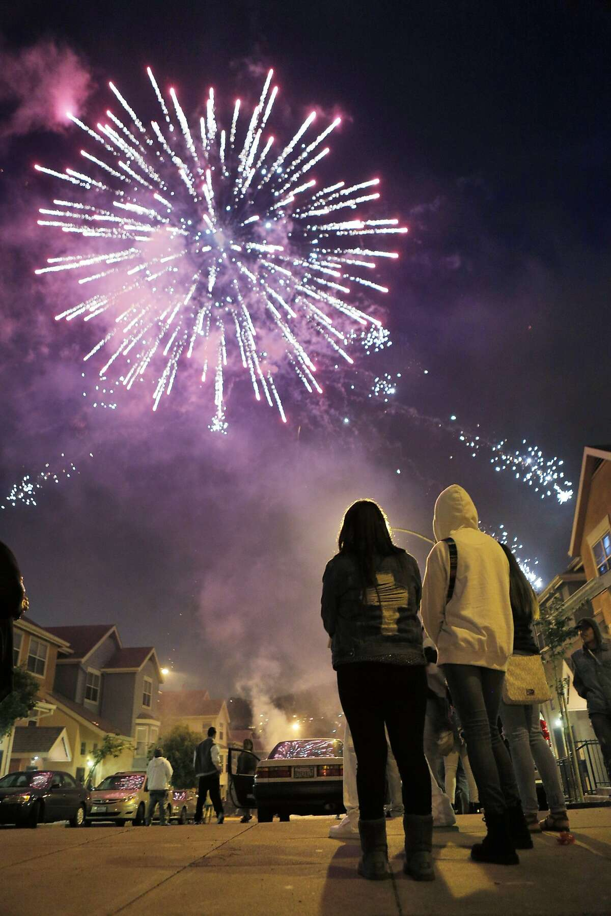 San Francisco residents in the Mission District watched fireworks of their own as the Fourth of July holiday came to a close on Friday night, July 4, 2014.