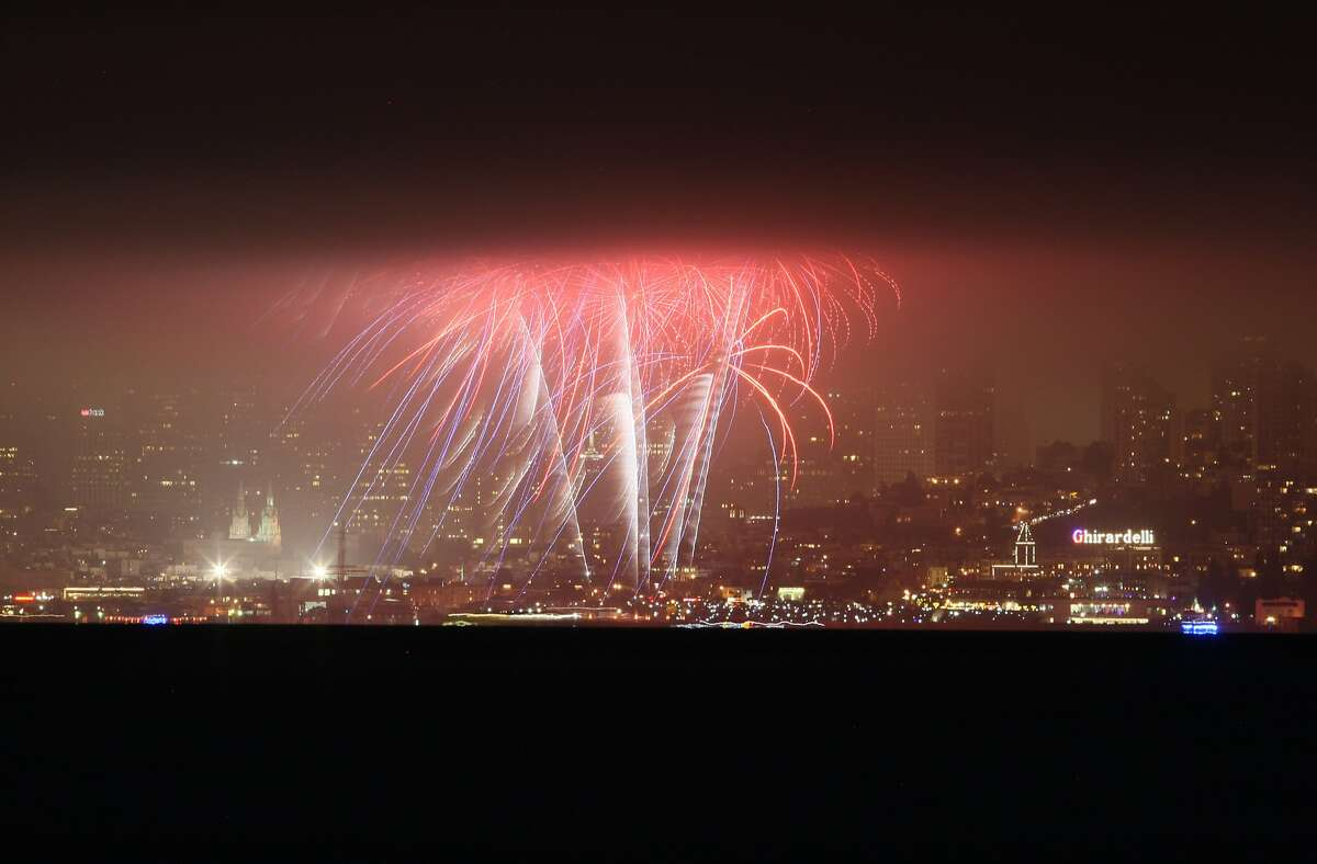 Fireworks explode over the San Francisco waterfront, as seen from the Sausalito waterfront on July 04, 2014 in San Francisco, CA.