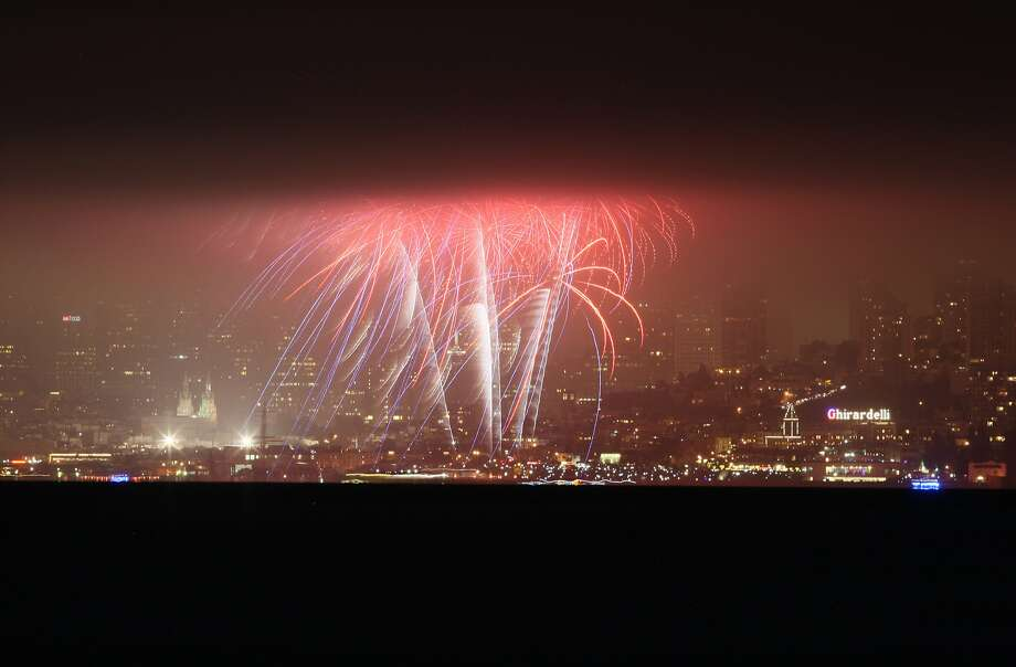 Fireworks explode over the San Francisco waterfront, as seen from the Sausalito waterfront on July 04, 2014 in San Francisco, CA. Photo: Craig Hudson, The Chronicle