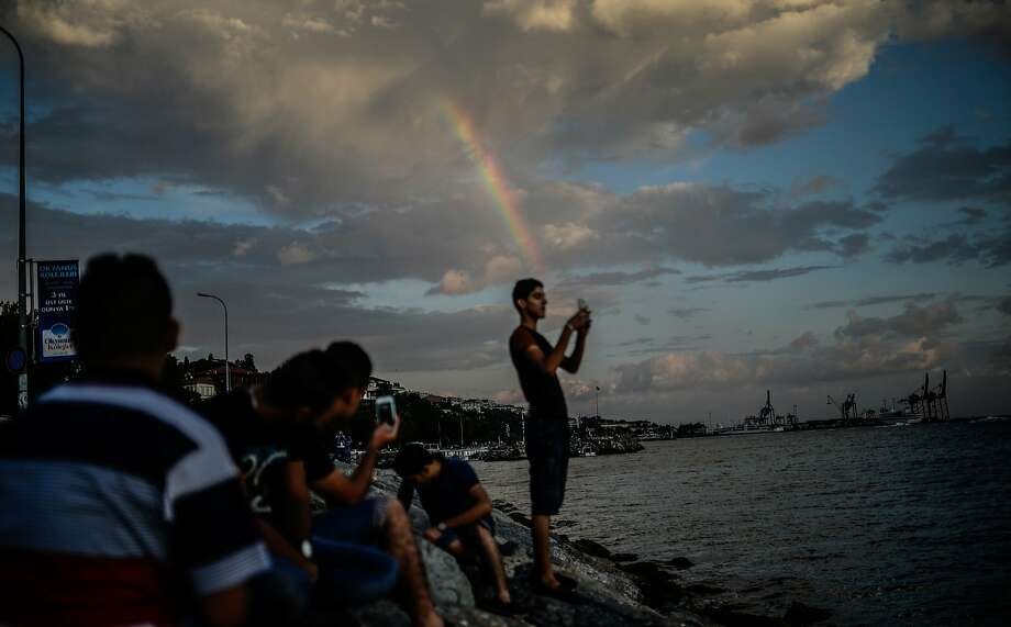 Turkish people enjoy near the Bosphorus on July 4, 2014 at Uskudar during the holy month of Ramadan in Istanbul. Muslim believers abstain from eating, drinking, smoking and having sex from dawn until sunset. AFP PHOTO/BULENT KILICBULENT KILIC/AFP/Getty Images Photo: Bulent Kilic, AFP/Getty Images
