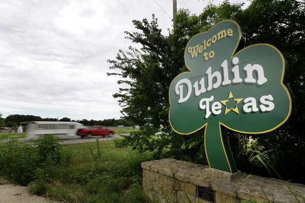 In this June 14, 2014 photo, a shamrock sign welcomes drivers to Dublin, Texas.  Most of Dublin's 3,887 residents believe the connection to Ireland is mythical, and that their town is more likely named after the settler expression for seeking protection from Plains attackers by circling their wagons at night, or doublin' up.