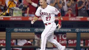 Mike Trout celebrates as he approaches home plate after hitting the game-winning solo home run in the ninth inning.