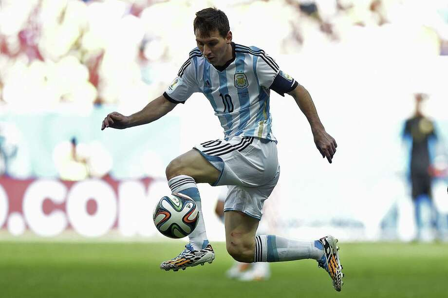 TOPSHOTS  Argentina's forward and captain Lionel Messi controls the ball during a quarter-final football match between Argentina and Belgium at the Mane Garrincha National Stadium in Brasilia during the 2014 FIFA World Cup on July 5, 2014. AFP PHOTO / JUAN MABROMATAJUAN MABROMATA/AFP/Getty Images Photo: JUAN MABROMATA, AFP/Getty Images / AFP