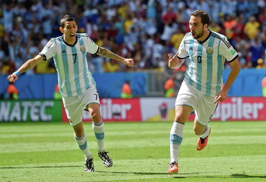 Argentina's Gonzalo Higuain, right, celebrates with Angel di Maria after scoring the opening goal during the World Cup quarterfinal soccer match between Argentina and Belgium at the Estadio Nacional in Brasilia, Brazil, Saturday, July 5, 2014. (AP Photo/Martin Meissner) Photo: Martin Meissner, Associated Press / AP