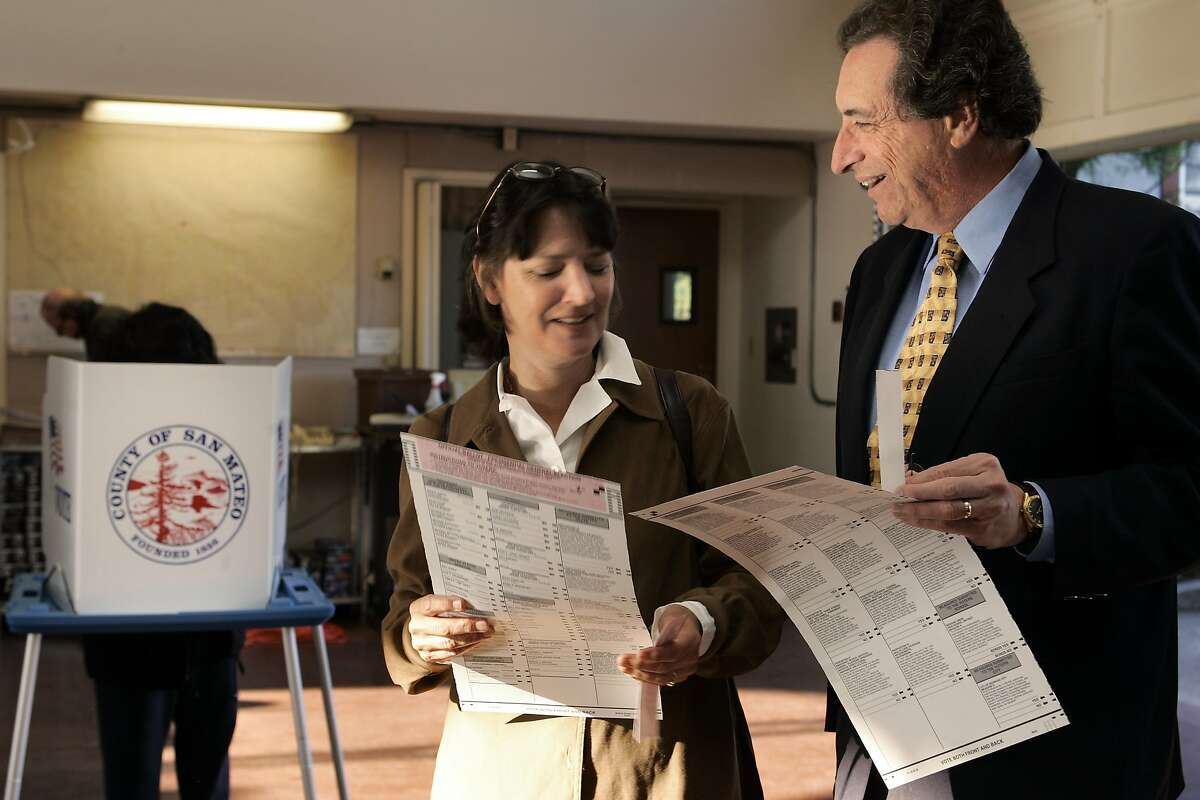 Democratic incumbent Ira Ruskin voting 11/2/04 at a Redwood City fire station with his wife, Cheryl.