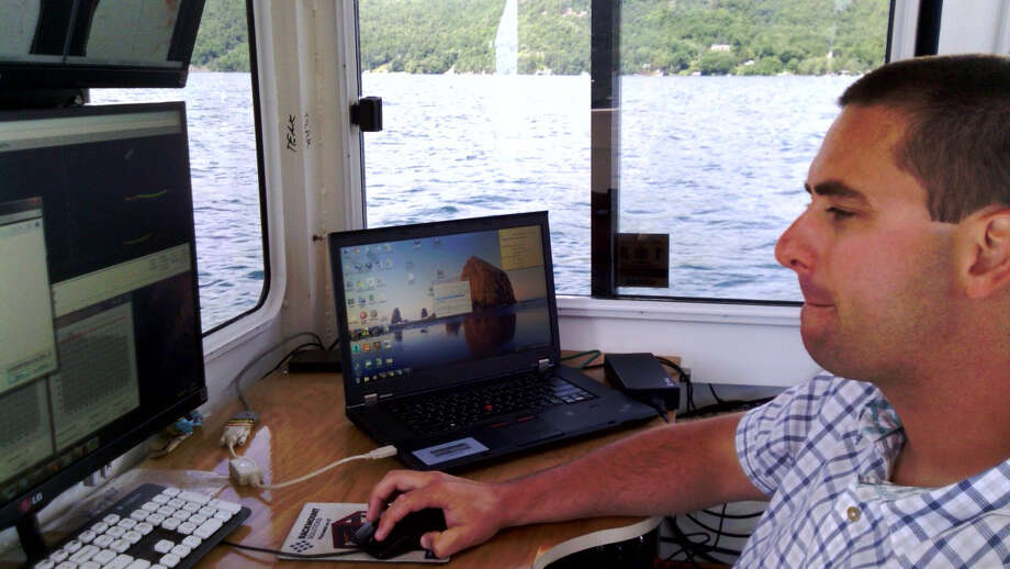 Bill Jenkins of Substructure monitors the lake bottom as the Orion scans Lake George. (Brian Nearing photo)