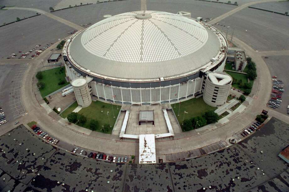 """FILE - This May 16, 1991, file photo, shows an aerial view of the Houston Astrodome in Houston. A glimmer of hope surfaced in the effort to keep the Houston Astrodome, the world's first multipurpose domed stadium, from being torn down with its addition this week to the National Register of Historic Places. But the designation alone will not be enough to prevent the demolition of the so-called """"Eighth Wonder of the World,"""" according to officials.  (AP Photo/Houston Chronicle, Larry Reese, File) MANDATORY CREDIT Photo: Larry Reese, MBI / Houston Chronicle"""