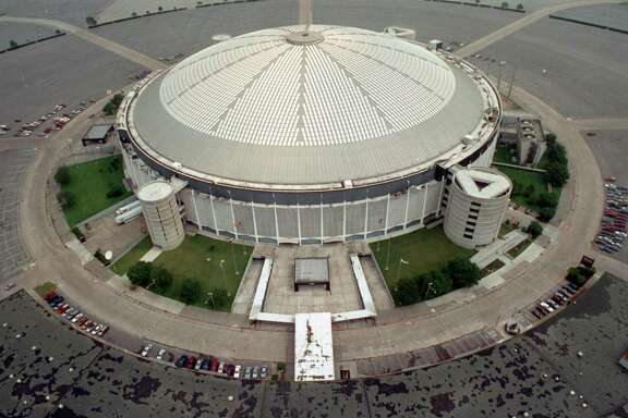 "FILE - This May 16, 1991, file photo, shows an aerial view of the Houston Astrodome in Houston. A glimmer of hope surfaced in the effort to keep the Houston Astrodome, the world's first multipurpose domed stadium, from being torn down with its addition this week to the National Register of Historic Places. But the designation alone will not be enough to prevent the demolition of the so-called ""Eighth Wonder of the World,"" according to officials.  (AP Photo/Houston Chronicle, Larry Reese, File) MANDATORY CREDIT"
