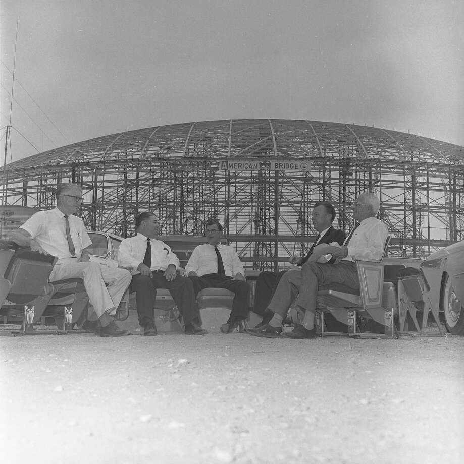 "In 1963, Harris County commissioners V.V. ""Red"" Ramsey, from left, E.A. ""Squatty"" Lyons, W. Kyle Chapman, County Judge Bill Elliott and Commissioner Philip Sayers check out stadium seats for the soon-to-be-completed Domed Stadium. Photo: Owen Johnson, HP Staff / Houston Post files"
