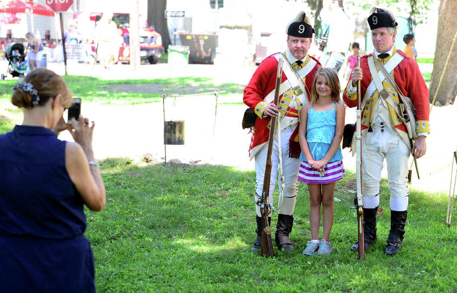 "Family Fun Fest held on the Town Hall Green and the Fairfield Museum and History Center in Fairfield, Conn. on Saturday July 5, 2014. The festival featured a full slate of musical entertainment, artisan fair, and games and activities for children. Also, Revolutionary War British soldier re-enactors were encamped on the premises, wearing the traditional ""red coat"" uniforms as well as firing replica period musket rifles. Photo: Christian Abraham / Connecticut Post"