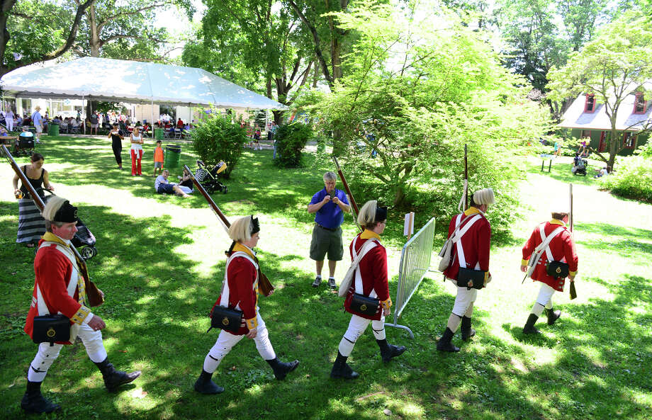 Revolutionary War re-enactors with the British Seventh Company of the Ninth Regiment of Foot, hold an encampment during Family Fun Fest held on the Town Hall Green and the Fairfield Museum and History Center in Fairfield, Conn. on Saturday July 5, 2014. The festival featured a full slate of musical entertainment, artisan fair, and games and activities for children. Photo: Christian Abraham / Connecticut Post