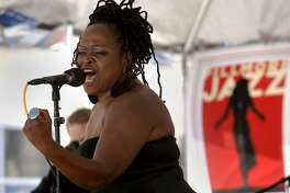 """Jazz singer Terrie Odabi, of Oakland, belts out a song as she plays the Fillmore Jazz Festival on Saturday July 5, 2014, in San Francisco, Calif. This year's 30th anniversary celebration of the Fillmore Jazz Festival embraces the spirit, insight, beauty, and power of women expressed through music, """"Celebrating Women in Jazz and Beyond""""."""