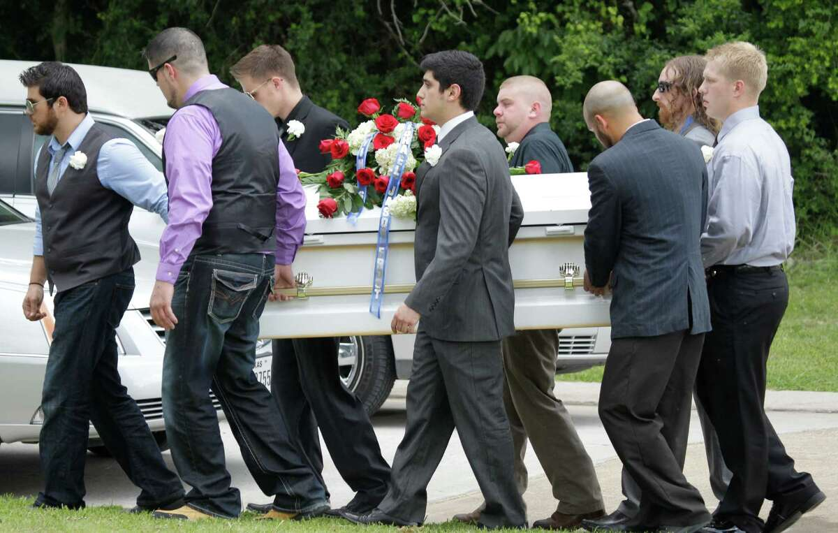 The casket of 9-year-old Jason Frost is carried to the graveside service at Rosewood Cemetery, 2602 South Houston Ave., Saturday, July 5, 2014, in Humble. He was among three people who died from a boating accident on Lake Conroe last week. His mother, Kristina Cole Frost, and her sister, Leilani Rose Cole, were also buried today at Rosewood.