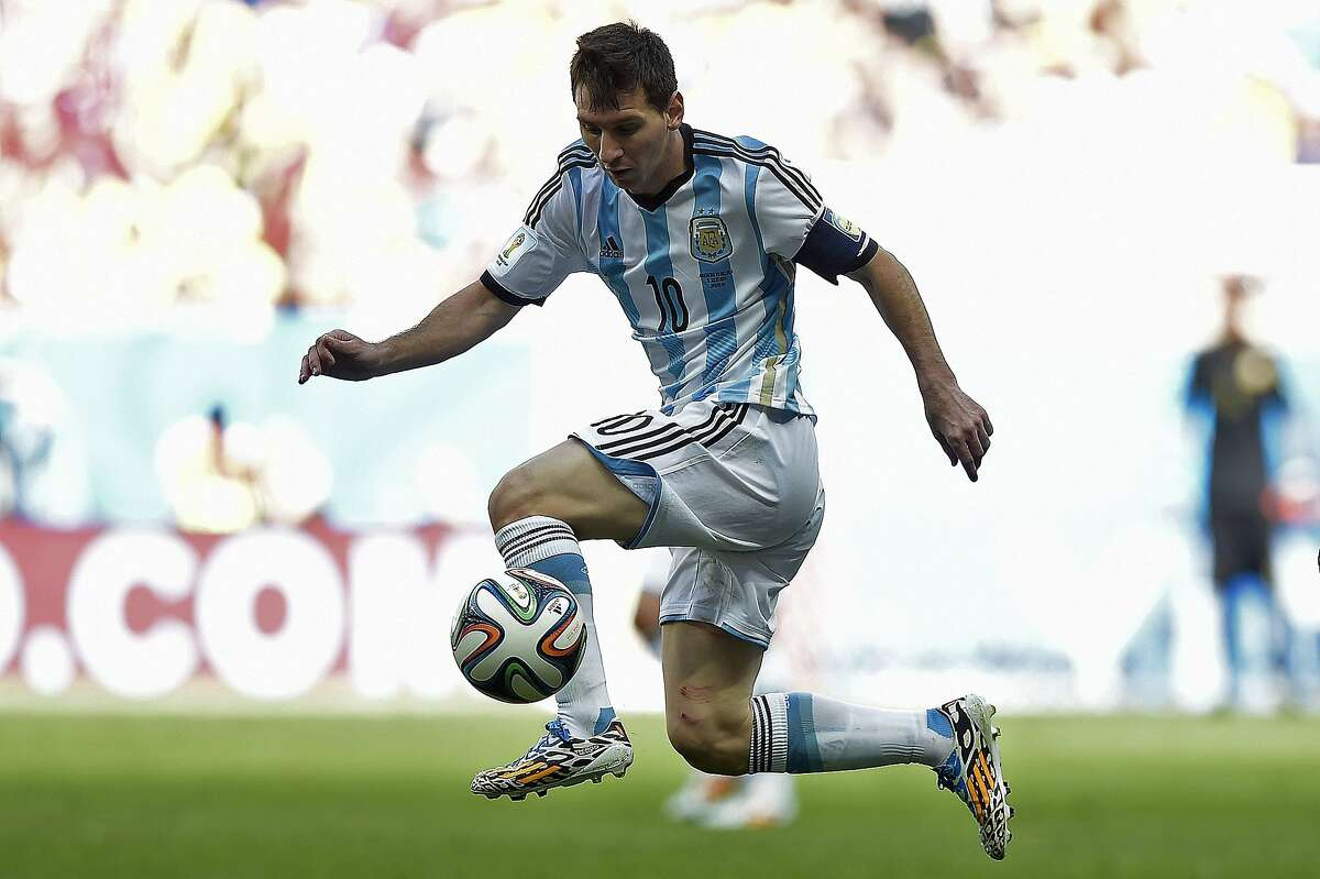 TOPSHOTS Argentina's forward and captain Lionel Messi controls the ball during a quarter-final football match between Argentina and Belgium at the Mane Garrincha National Stadium in Brasilia during the 2014 FIFA World Cup on July 5, 2014. AFP PHOTO / JUAN MABROMATAJUAN MABROMATA/AFP/Getty Images