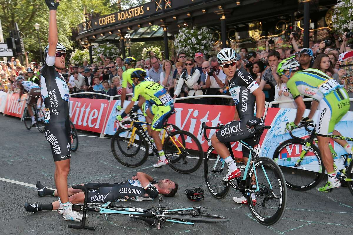 Britain's Mark Cavendish lies injured after a fall near the finish line at the end of the 190.5 km first stage of the 101st edition of the Tour de France cycling race on July 5, 2014 between Leeds and Harrogate, northern England. The 2014 Tour de France gets underway on July 5 in the streets of Leeds and ends on July 27 down the Champs-Elysees in Paris. AFP PHOTO / POOL / FRED MONSFRED MONS/AFP/Getty Images