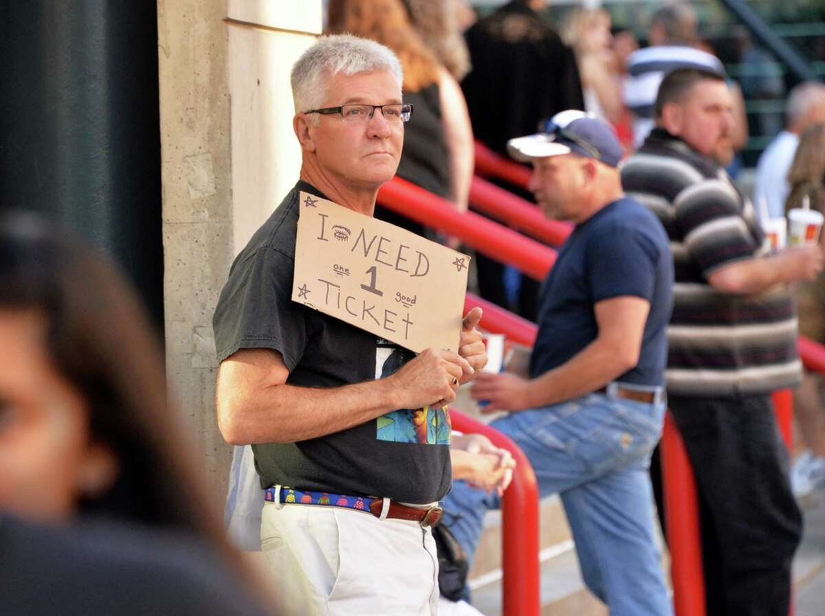 A hopeful Ed Warzala of New Paltz tries for a ticket outside the Times Union Center before the Paul McCartney Out There tour concert Saturday July 5, 2014, in Albany, NY. (John Carl D'Annibale / Times Union)
